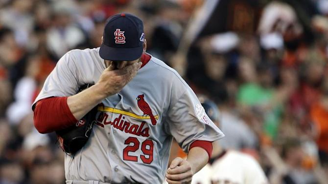 FILE - In this Oct. 21, 2012, file photo, St. Louis Cardinals starting pitcher Chris Carpenter reacts after giving up a triple to San Francisco Giants' Brandon Belt during the second inning of Game 6 of baseball's National League championship series in San Francisco. Carpenter is unlikely to pitch for the Cardinals this season and his career may be over because of a nerve injury that kept him out most of last year, general manager John Mozeliak said Tuesday, Feb. 5, 2013. (AP Photo/David J. Phillip, File)
