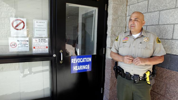 Deputy Sheriff Olgin stands outside the San Bernardino County West Valley Detention Center in Rancho Cucamonga