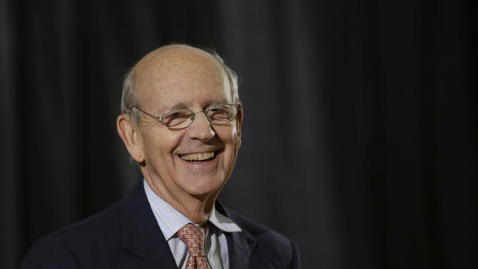In this photo taken Jan. 24, 2013, file photo U.S. Supreme Court Justice Stephen Breyer reacts during a lecture at Boston University School of Law in Boston. Breyer is in a Washington hospital after shoulder replacement surgery following a bicycle accident injury to his right shoulder Friday, April 26, 2013. Court spokeswoman Kathy Arberg says the 74-year-old Breyer is expected to make a full recovery following the operation Saturday. Previously he broke his collarbone in an accident in 2011 and sustained broken ribs and a punctured lung in a bicycle mishap in 1993, before he joined the court. (AP Photo/Elise Amendola)
