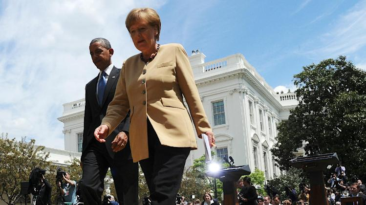 US President Barack Obama (L) and German Chancellor Angela Merkel walk to the Oval Office in the White House on May 2, 2014 in Washington