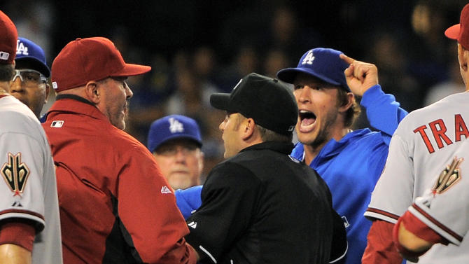 Los Angeles Dodgers starting pitcher Clayton Kershaw, right, yells as Arizona Diamondbacks manager Kirk Gibson, left, as umpire Clint Fagan separates them after Los Angeles Dodgers' Zack Greinke was hit by a pitch during the seventh inning of their baseball game, Tuesday, June 11, 2013, in Los Angeles.  (AP Photo/Mark J. Terrill)