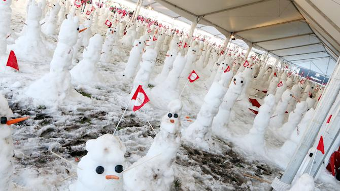 IMAGE DISTRIBUTED FOR MATTEL - Snowmen in Southern California wait to be measured in an attempt to break the Guinness World Record for most snowmen built in one hour at Mattel Headquarters on Thurs., Dec. 13, 2012 in El Segundo, Calif. (Photo by Casey Rodgers/Invision for Mattel/AP Images)