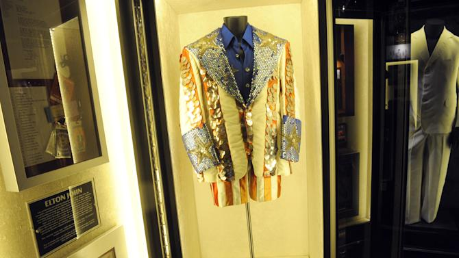 """Elton John's sequined """"Uncle Sam"""" outfit is displayed at the launch of Hard Rock International's traveling music memorabilia collection, """"Music GIves Back,"""" Wednesday, Feb. 13, 2013, at Hard Rock Cafe New York.   """"Music Gives Back"""" focuses on artists who have worked with Hard Rock on charitable campaigns  and will be on tour at Hard Rock locations in the U.S. throughout 2013. (Photo by Diane Bondareff/Invision for Hard Rock International/AP Images)"""