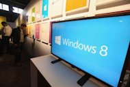 A screen displays the logo of Microsoft's Windows 8 operating system at a press conference for its launch on October 25 in New York City. The company kicked off sales of the system and its Surface tablet Friday amid mixed reviews as the tech giant ramped up efforts to compete in a market shifting rapidly from PCs to mobile devices