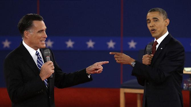 In this Oct. 16, 2012 file photo, Republican presidential candidate, former Massachusetts Gov. Mitt Romney and President Barack Obama spar during the second presidential debate at Hofstra University in Hempstead, N.Y. (AP Photo/Charlie Neibergall, File)