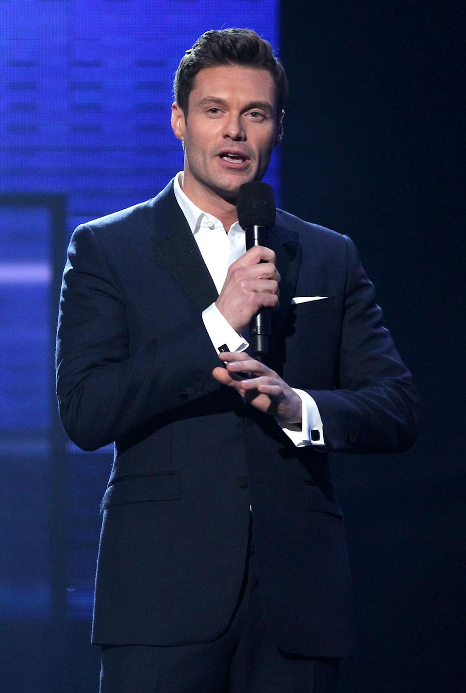 Ryan Seacrest presents the award for favorite male artist - pop/rock at the 40th Annual American Music Awards on Sunday, Nov. 18, 2012, in Los Angeles. (Photo by Matt Sayles/Invision/AP)