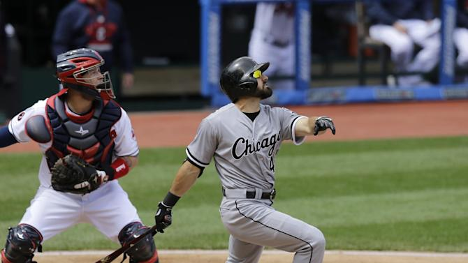 Chicago White Sox center fielder Adam Eaton watches his ball after hitting in a baseball game against the Cleveland Indians, Wednesday, April 15, 2015, in Cleveland. Cleveland Indians catcher Roberto Perez watches. (AP Photo/Tony Dejak)