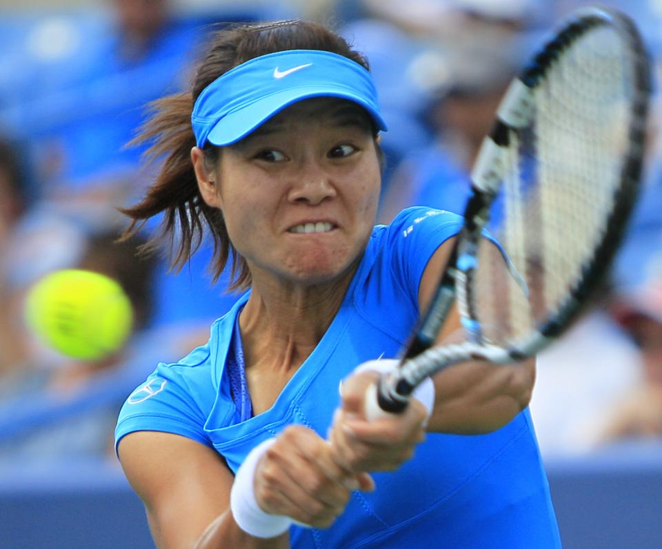 Li Na, of China, hits a backhand against Angelique Kerber, of Germany, during the women's final at the Western & Southern Open tennis tournament, Sunday, Aug. 19, 2012, in Mason, Ohio. (AP Photo/Al Behrman)