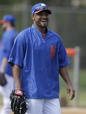New York Mets starting pitcher Johan Santana reacts during a spring training baseball workout, Thursday, Feb. 21, 2013, in Port St. Lucie, Fla. (AP Photo/Julio Cortez)