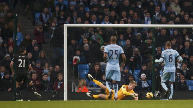 Burnley's George Boyd shoots to score a goal against Manchester City during their English Premier League soccer match at the Etihad Stadium in Manchester