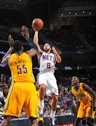 NEWARK, NJ - MARCH 28: Deron Williams #8 of the New Jersey Nets shoots over Roy Hibbert #55 of the Indiana Pacers on March 28, 2012 at the Prudential Center in Newark, New Jersey. (Photo by Jesse D. Garrabrant/NBAE via Getty Images)
