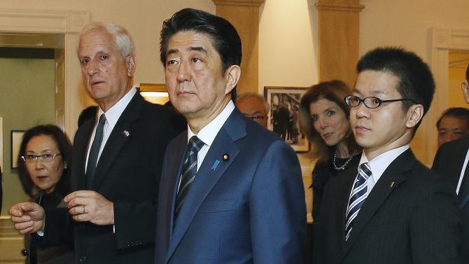 Japanese Prime Minister Shinzo Abe, center, tours the John F. Kennedy Presidential Library in Boston, with Edwin Schlossberg, second from left, and Caroline Kennedy, background right,  Sunday, April 26, 2015. (AP Photo/Michael Dwyer)