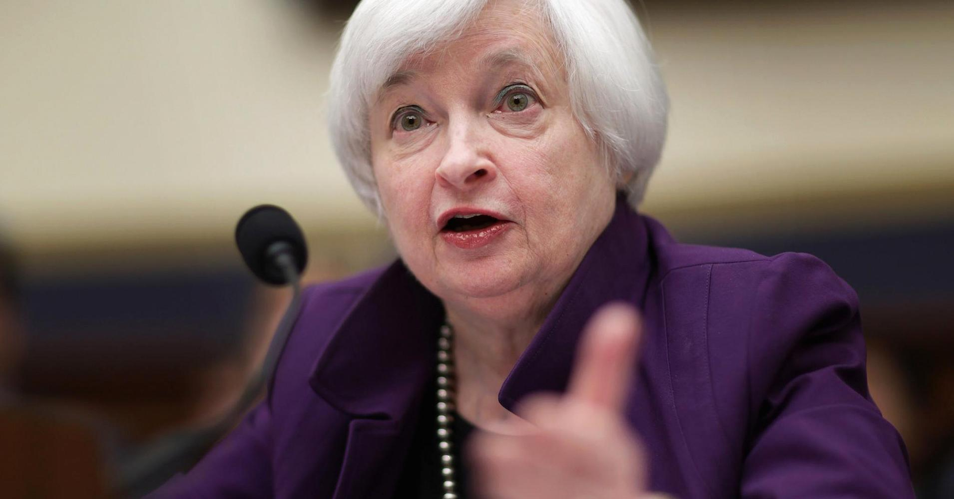 Yellen defends Fed policy, calls for gradual hikes