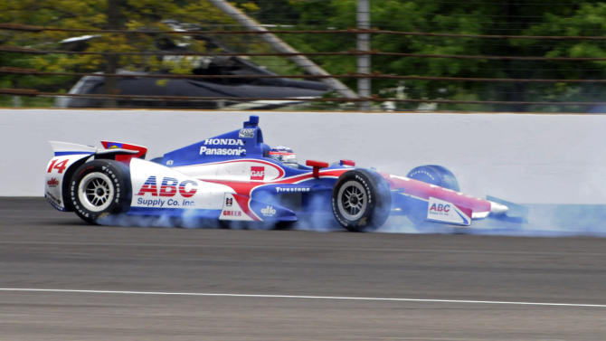 Takuma Sato, of Japan, spins in the second turn during the Indianapolis 500 auto race at the Indianapolis Motor Speedway in Indianapolis, Sunday, May 26, 2013. Sato made no contact and returned to the race. (AP Photo/John Maxwell)