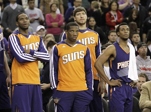 Members of the Phoenix Suns watch as Sacramento Kings guard Isaiah Thomas sinks two free throws in the closing moments of an NBA basketball game to secure a 107-104 win in Sacramento, Calif., Tuesday,