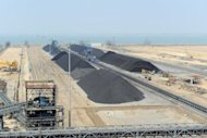 Mounds of coal are seen in India in 2011. Coal India, the world's biggest coal miner, on Monday reported a five percent drop in quarterly profit from a year earlier after staff costs doubled