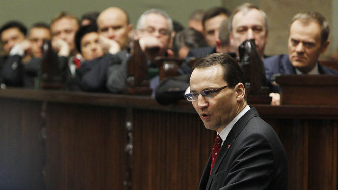 """FILE- In this Thursday, March 20, 2013 file photo, Poland's Foreign Minister Radek Sikorski delivers his policy speech to lawmakers, in Warsaw, Poland. A Polish magazine said Sunday, June 22, 2014, it has obtained recordings of a private conversation in which Foreign Minister Radek Sikorski says the country's strong alliance with the U.S. """"isn't worth anything"""" and is """"even harmful because it creates a false sense of security."""" In a short transcript of the conversation, a person identified as Sikorski by the magazine Wprost tells former finance minister, Jacek Rostowski, that Poles naively believe the U.S. bolsters their security. (AP Photo/Czarek Sokolowski, File)"""