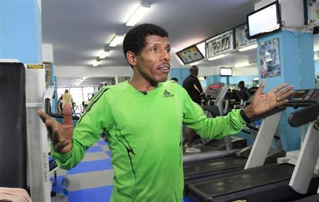 Ethiopian marathon runner Haile Gebrselassie speaks during a Reuters interview in his gymnasium in Ethiopia's capital Addis Ababa