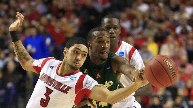 Louisville guard Peyton Siva (3) steals the ball from Colorado State forward Greg Smith (44) in the second half of a third-round NCAA college basketball tournament game on Saturday, March 23, 2013, in Lexington, Ky. (AP Photo/James Crisp)