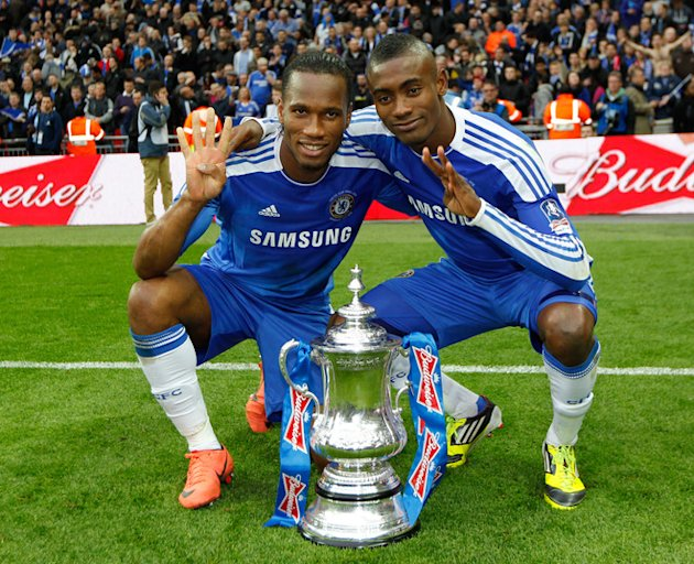 Chelsea's Ivorian Players Didier Drogba (L) And Salomon Kalou (R) Celebrate On The Pitch 