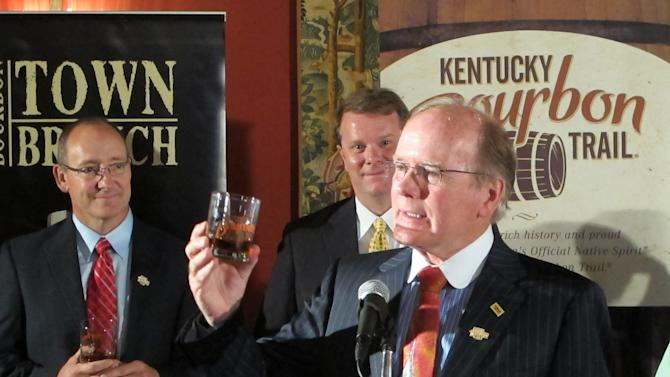 Alltech President Pearse Lyons raises his glass to offer a toast on Thursday, Aug. 16, 2012, in Lexington, Ky., as Alltech's Lexington Brewing & Distilling Co. joins the Kentucky Bourbon Trail. The trail featuring seven distilleries has become a popular tourist attraction in Kentucky. (AP Photo/Bruce Schreiner)