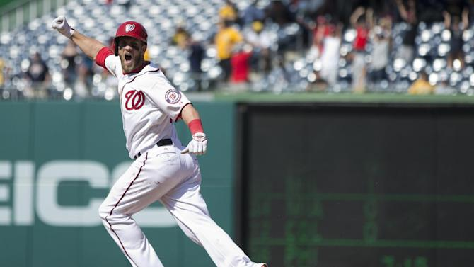 Washington Nationals' Bryce Harper celebrates his game winning two-run home run as he rounds the bases in the ninth inning of a baseball game against the Pittsburgh Pirates at Nationals Park on Thursday, July 25, 2013, in Washington. The Nationals won 9-7. (AP Photo/Evan Vucci)