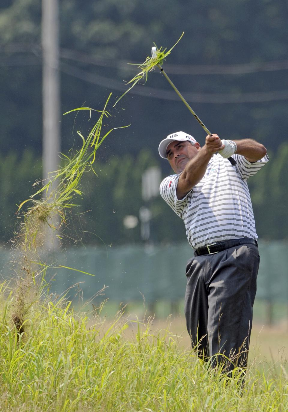 Angel Cabrera, of Argentina,  hits out of the deep rough on the seventh hole during the second round of the Travelers Championship golf tournament in Cromwell, Conn., Friday, June 22, 2012. (AP Photo/Fred Beckham)