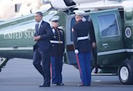 US President Barack Obama steps off Marine One May 10, on arrival at Bob Hope Airport in Burbank, California. Obama jetted into Hollywood for a George Clooney-hosted fundraiser Thursday tipped to make a record-breaking $15 million, and add a touch of stardust to his re-election campaign