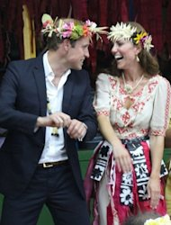 Prince William (L) and his wife Catherine dance during a 'fatale', a singing and dancing event in Tuvalu on September 18, 2012. French authorities on Tuesday banned Closer magazine from any further distribution of the pictures of Catherine topless and began a criminal probe into how they were obtained.