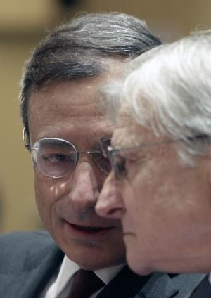 European Central Bank head Jean-Claude Trichet, right, listens to Mario Draghi, next to take the helm of the European Central Bank, during a conference on the debt crisis, Monday Sept. 5, 2011, in Paris.  Trichet says Europe's debt crisis has revealed the weaknesses of the eurozone but that it has created a will to keep spending in check. (AP Photo/Michel Euler)