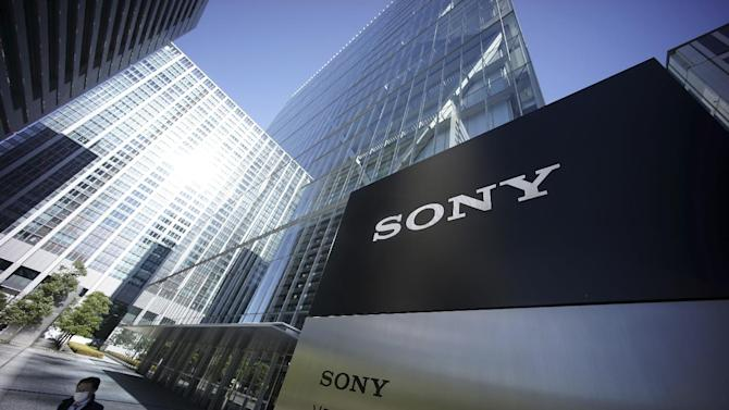 """A man walks out from the headquarters of Sony Corp. in Tokyo Thursday, Dec. 18, 2014. Sony's miseries with its television and smartphone businesses were bad enough. Now its American movie division, a trophy asset, is facing tens of millions of dollars in losses from leaks by hackers that attacked the company over a movie that spoofs an assassination of North Korean leader Kim Jong Un. Sony Pictures canceled all release plans for the film at the heart of the hack, """"The Interview.""""  (AP Photo/Eugene Hoshiko)"""