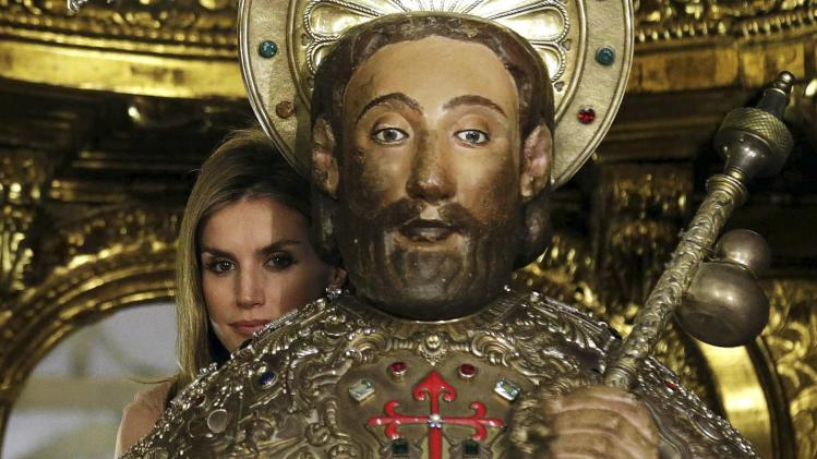 Spain's Queen Letizia embraces the figure of St James as is traditional on the saint's feast day inside the cathedral in Santiago de Compostela