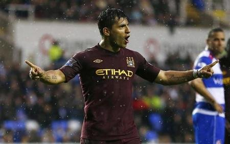 Manchester City's Aguero celebrates after scoring during their English Premier League soccer match against Reading at the Madejski Stadium