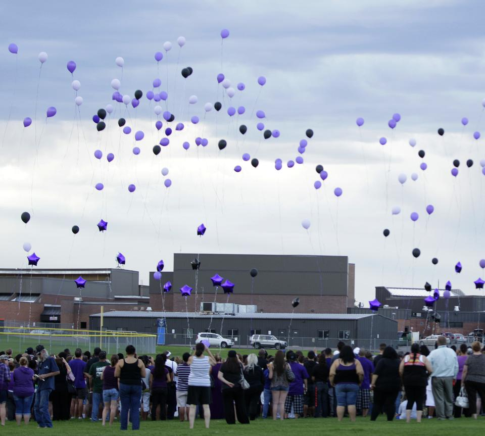 Balloons are released Saturday, July 21, 2012, at a vigil at Gateway High School in Aurora, Colo., for AJ Boik, who was a student at the school and who was killed along with 11 others when a gunman opened fire in a movie theater. (AP Photo/Ted S. Warren)