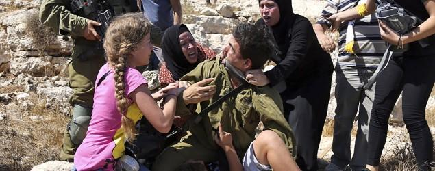 Israeli soldier, Palestinian women scuffle on video