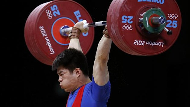 China&#39;s Qingfeng Lin competes on the men&#39;s 69Kg Group A weightlifting competition at the ExCel venue at the London 2012 Olympic Games (Reuters)