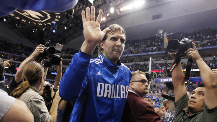 Dallas Mavericks' Dirk Nowitzki leaves the floor after the Mavericks beat the Los Angeles Lakers 122-86 in Game 4 of a second-round NBA playoff basketball series, Sunday, May 8, 2011, in Dallas. The Mavericks swept the series. (AP Photo/Richard W. Rodriguez)