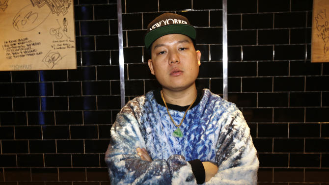 "In this Monday, Jan. 28, 2013 photo, chef Eddie Huang poses for a portrait at his restaurant Baohaus in New York. Huang unveils a biting new memoir, ""Fresh Off the Boat,"" about race, immigration, and, yes, food. (AP Photo/Seth Wenig)"