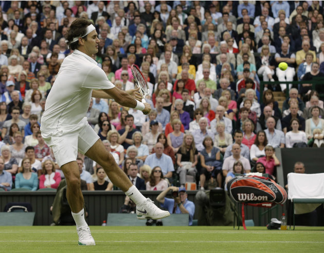 Roger Federer of Switzerland plays a shot to Novak Djokovic of Serbia during a semifinals match at the All England Lawn Tennis Championships at Wimbledon, England, Friday, July 6, 2012. (AP Photo/Anja