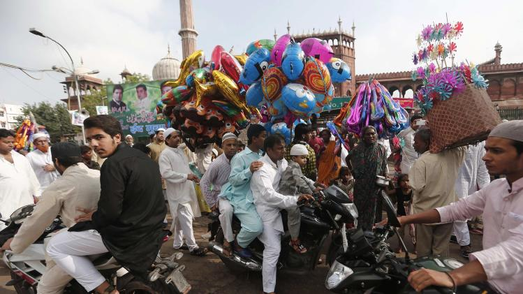 Muslims leave after offering Eid al-Fitr prayers outside the Jama Masjid in the old quarters of Delhi