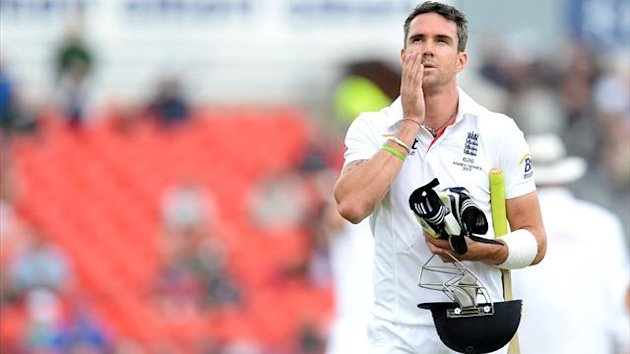 England's Kevin Pietersen leaves the pitch after being given out