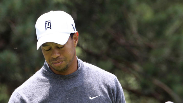 Tiger Woods reacts after teeing off on the second hole during the third round of the Memorial golf tournament at the Muirfield Village Golf Club in Dublin, Ohio, Saturday, June 2, 2012. Woods parred the hole. (AP Photo/Tony Dejak)