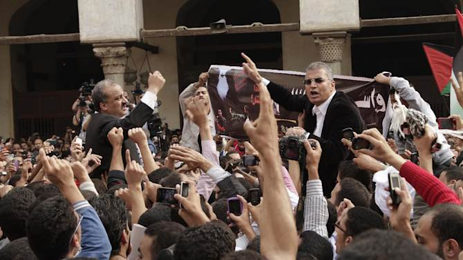 Protesters led by senior Muslim Brotherhood figure Mohammed Beltagi, left, and former member of the Egyptian Parliament, Essam Soltan chant slogans against the Israeli invasion of Gaza, in Al-Azhar mosque after Friday prayers, in Cairo, Egypt, Friday, Nov.16, 2012. In his Friday sermon at Al-Azhar, influential cleric Sheikh Yusuf al-Qaradawi, not shown, said the Islamic world would not be silent in the face of Israel's military operation in Gaza. (AP Photo/Thomas Hartwell)