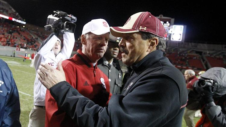 North Carolina State coach Tom O'Brien, left, greets Boston College coach Frank Spaziani after N.C. State's 27-10 victory in an NCAA college football game Saturday, Nov. 24, 2012, in Raleigh, N.C. (AP Photo/The News & Observer, Ethan Hyman) MANDATORY CREDIT
