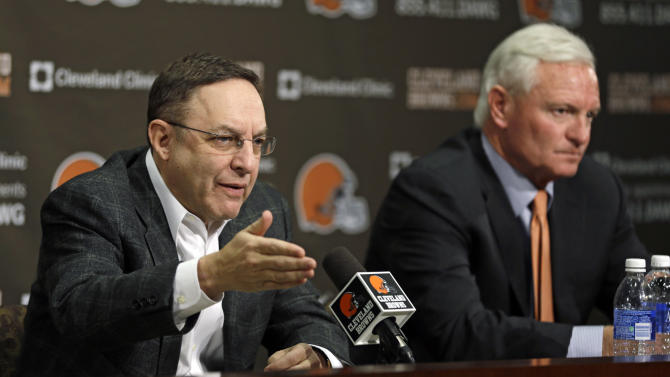 Cleveland Browns CEO Joe Banner, left, and new owner Jimmy Haslam answer questions during a news-conference at the Browns' NFL football training facility Monday, Dec. 31, 2012, in Berea, Ohio. One day after ending yet another dismal season with a loss in Pittsburgh, Cleveland fired coach Pat Shurmur and general manager Tom Heckert, the first moves in what is expected to be a massive offseason overhaul by Haslam. (AP Photo/Tony Dejak)