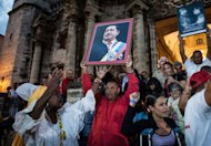 People attend a Catholic mass for the health of Venezuelan President Hugo Chavez in Havana on January 12, 2013. Has Venezuela&#39;s capital -- and decision-making process -- moved to Havana? For all practical purposes, and insultingly to Venezuelans, the answer is yes, say parties opposed to Chavez, who underwent cancer surgery a month ago in Cuba&#39;s capital and remains there, recovering