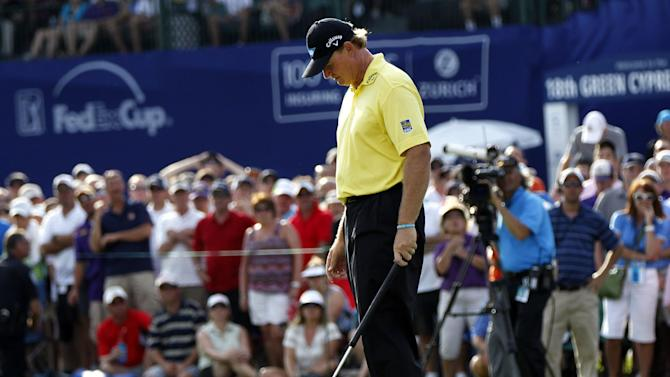 Ernie Els reacts after missing a putt on the 18th green during a sudden-death playoff against Jason Dufner at the Zurich Classic golf tournament at TPC Louisiana in Avondale, La., Sunday, April 29, 2012. Dufner won on the next stroke. (AP Photo/Gerald Herbert)