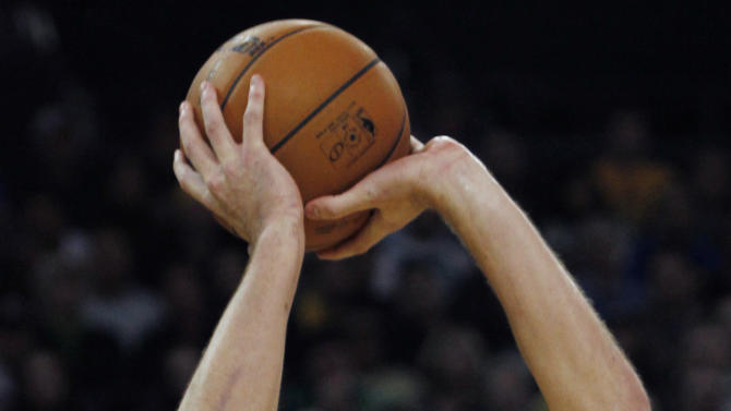 Golden State Warriors' David Lee shoots against the Boston Celtics during the second half of an NBA basketball game in Oakland, Calif., Saturday, Dec. 29, 2012. (AP Photo/George Nikitin)