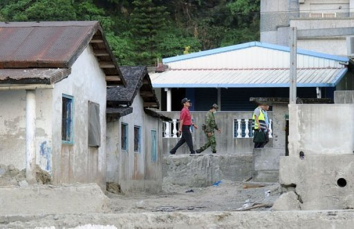 Local officials, military soldiers and policemen patrol the village of Heping, in eastern Hualien county, before the arrival of Typhoon Tembin.