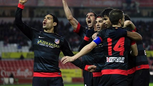 Atletico Madrid&#39;s Radamel Falcao celebrates after scoring against Sevilla in the Copa del Rey (Reuters)